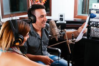 Singers creating a jingle for a tv ad